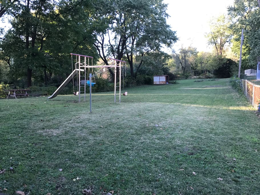 The one acre garden in the back is fenced and has a jungle gym. This space is shared with our basement tenant (totally separate living space).
