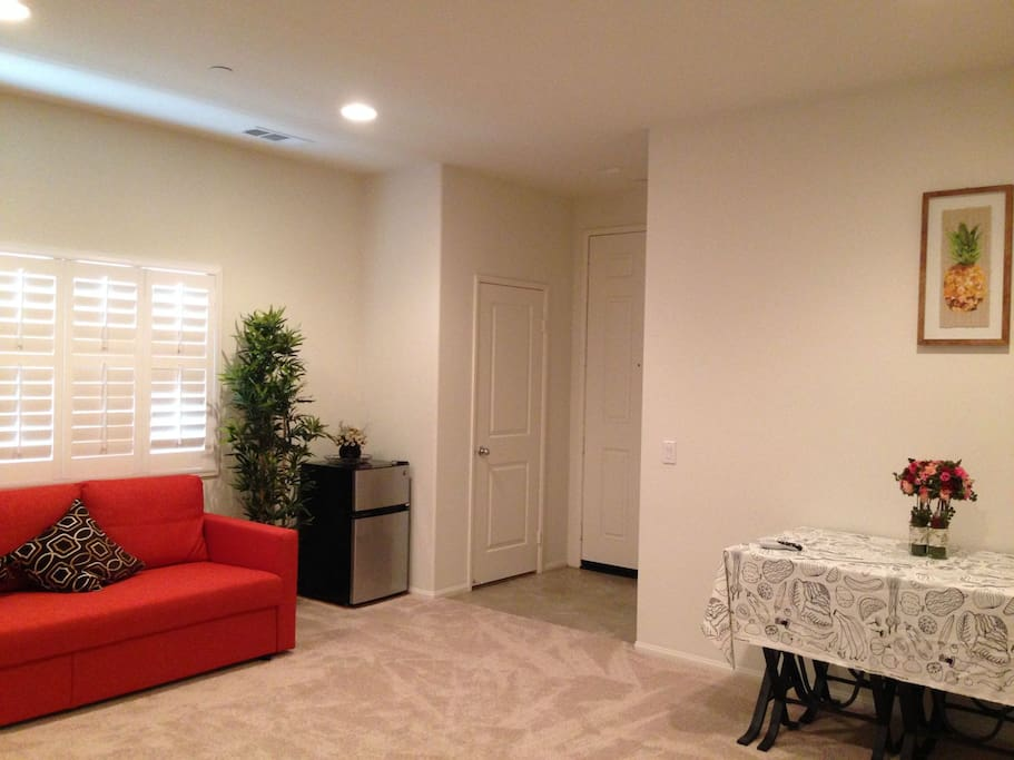 living room with a sofa convertible to a double bed;  small refrigerator included at the corner.