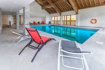 Spend time with family and friends around the indoor pool.