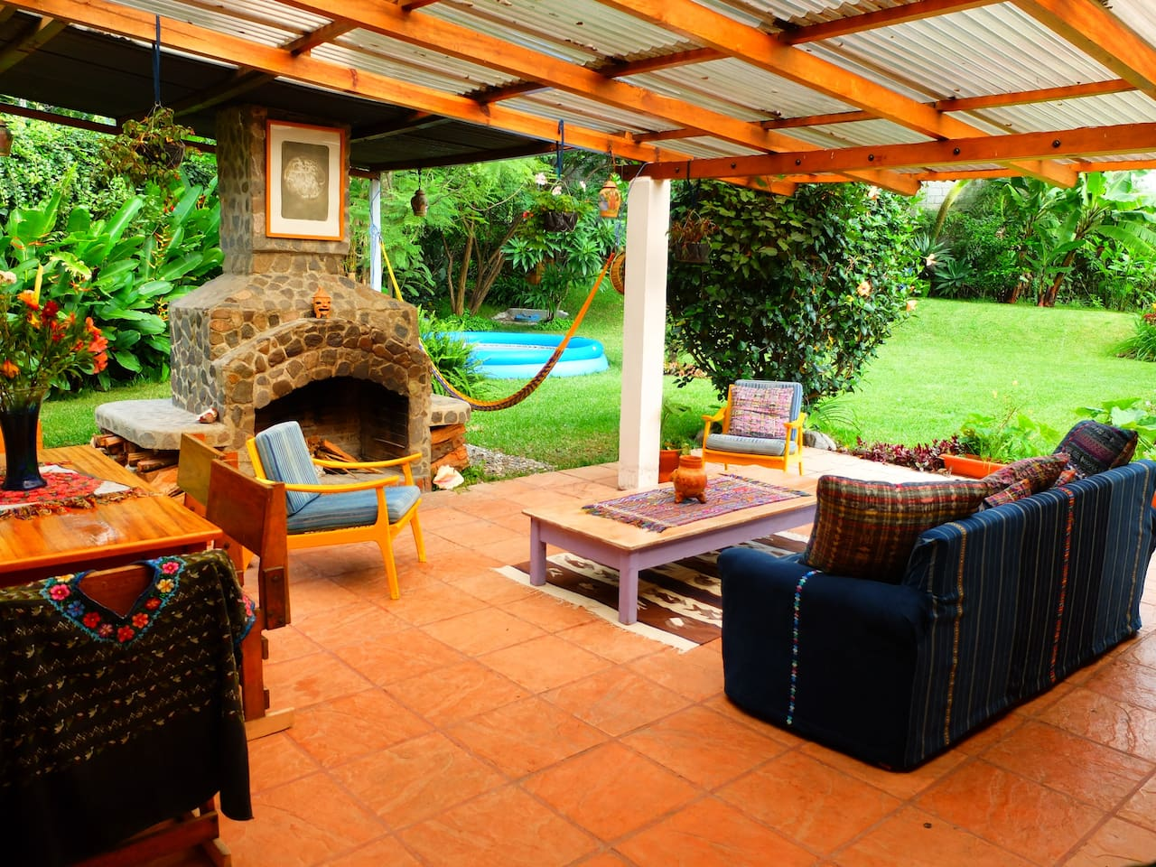 Wonderful outside Patio with fireplace and garden view.