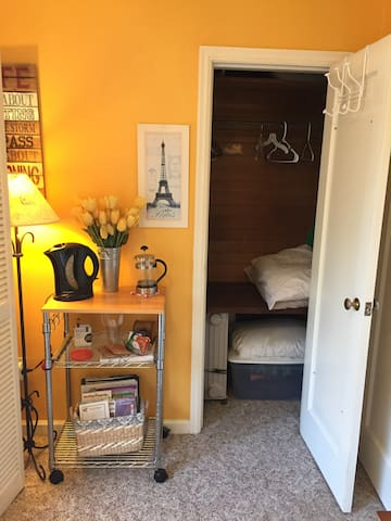 Closet with space for luggage, space heater, ironing board, extra pillows and blankets