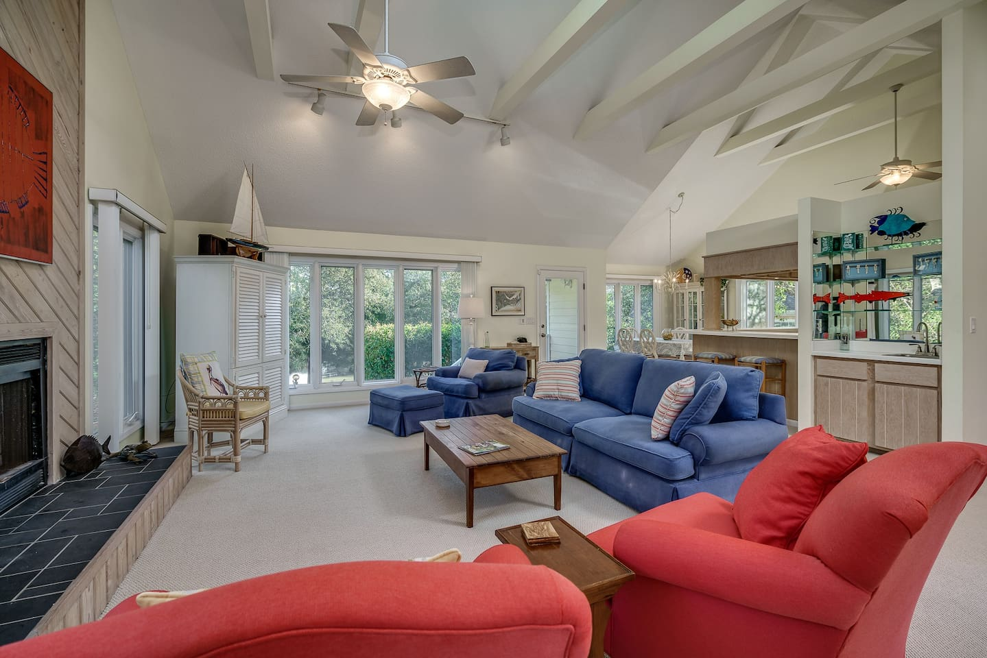 Open living room with vaulted ceiling and skylight