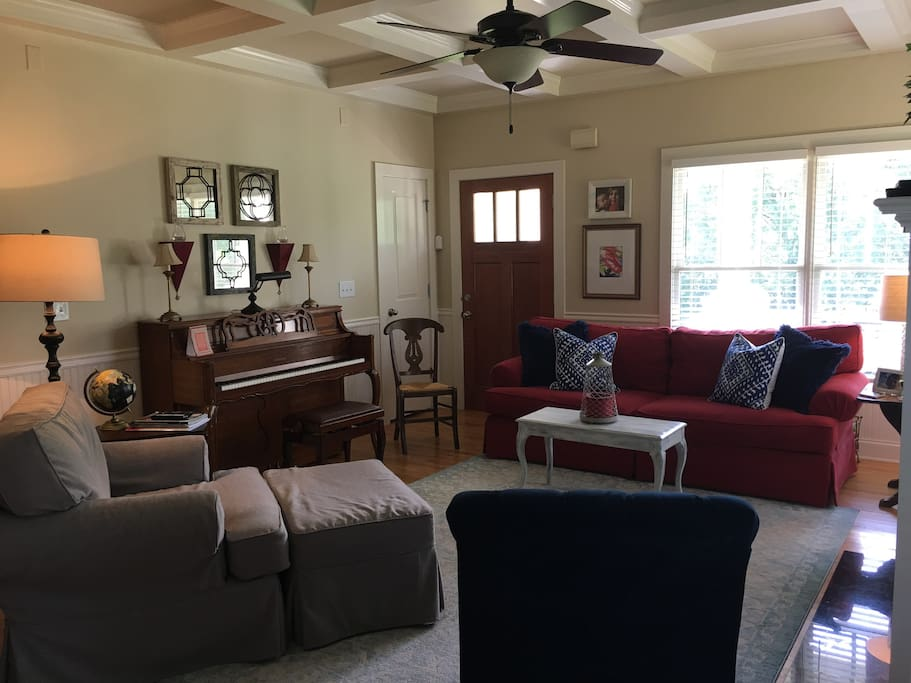 Cozy living room. Red sofa can be used as twin bed with back cushions removed. Many of our family's guests have rested easy and comfortably on this sofa.