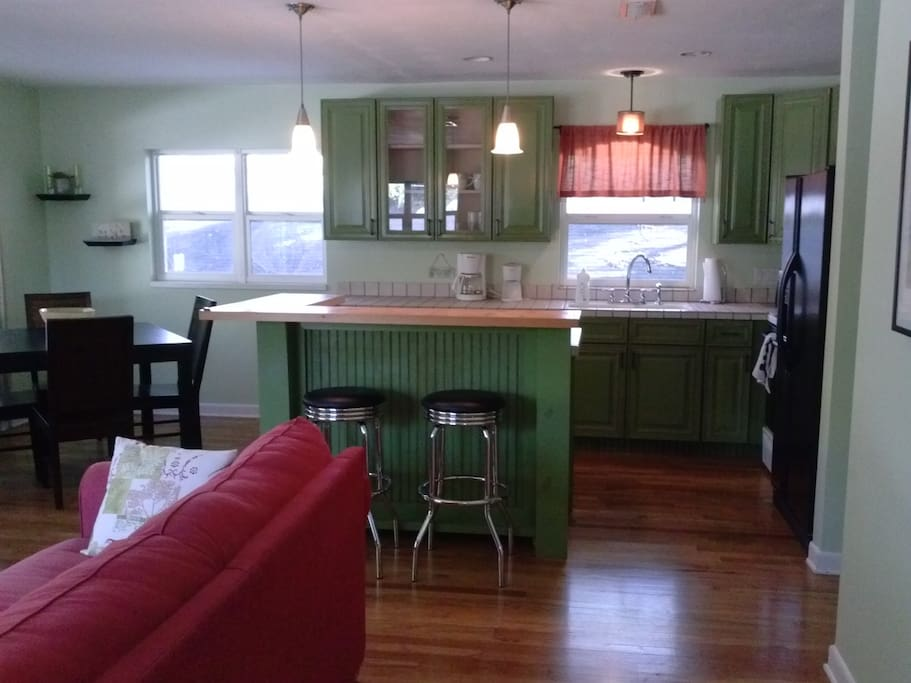 Newly renovated, spacious, and comfortable with beautiful hardwood floors and lots of natural light and a bar overlooking the kitchen.