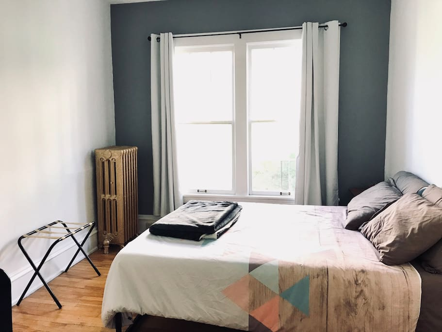 Your private bedroom with two huge windows, queen bed, desk, TV w/ streaming services, blackout curtains, closet, and more!