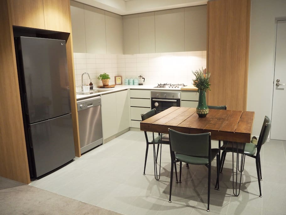Fully appointed kitchen with gas cooktop, 60cm oven, dishwasher and brand new stainless steel fridge / freezer.