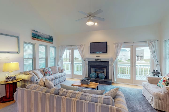 NEW LISTING!Elegant home w/elevated deck & shared pool-great water/surf views!