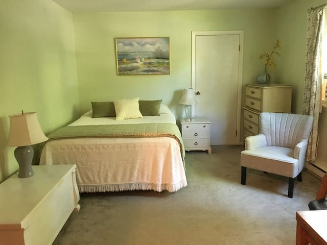 Impeccably clean room with queen bed and fridge