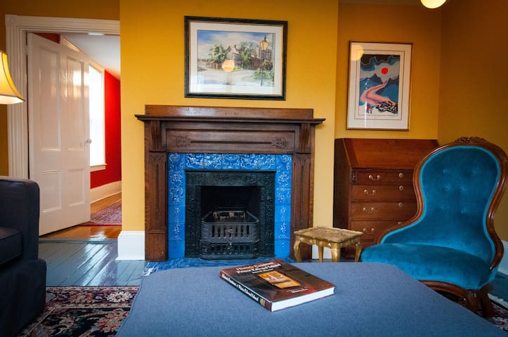 The living room with fireplace surround made of Delft tile.