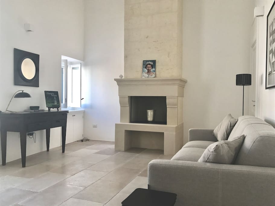 Sitting room with Lecce stone fireplace and sofa bed