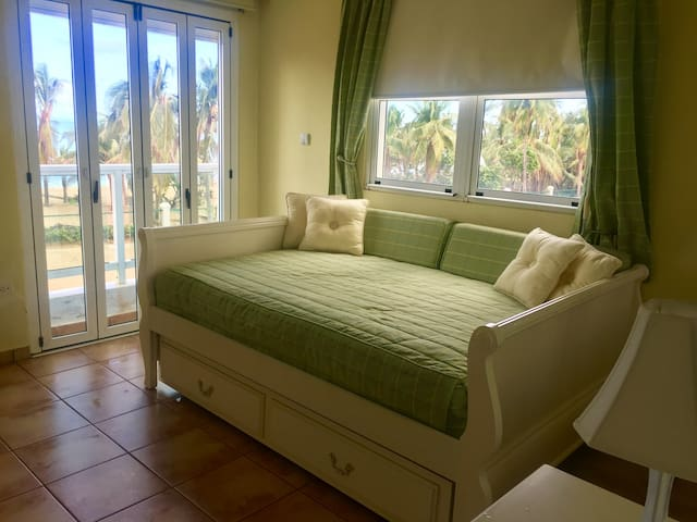 Second guest room with balcony, with two full sized beds (one of them pulls out from underneath)