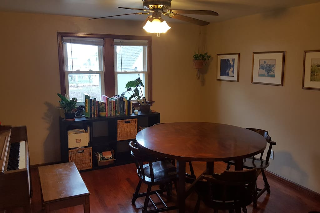 Main room/dining room.  Includes a piano.