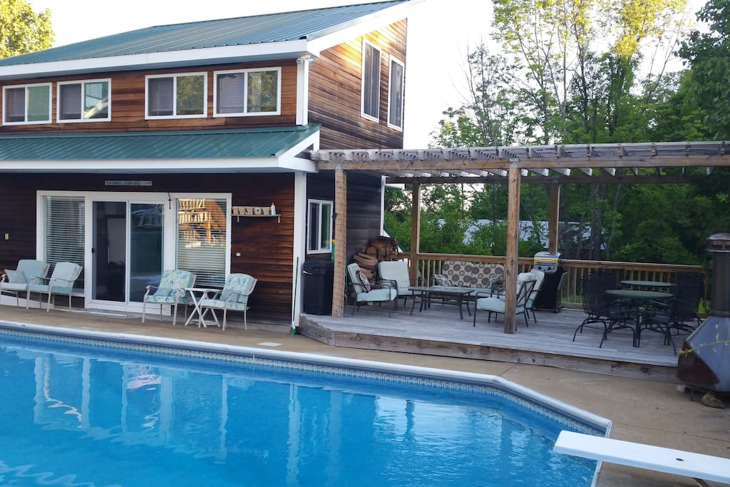 Pool cottage and deck with lounge and dining areas