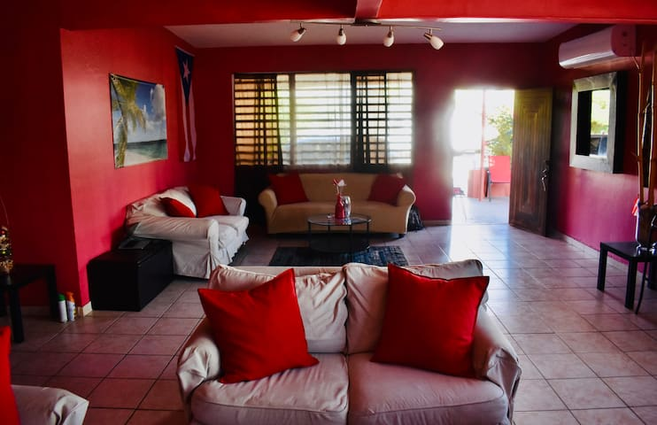 Living room with AC, TV, Cable TV, DVD player, WIFI, 2 pairs of sofas and dinning table with 6 chairs.