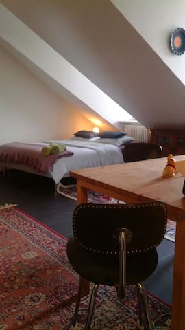 The bed and the livingroom. (the wooden table is now substituted with another beautiful table)