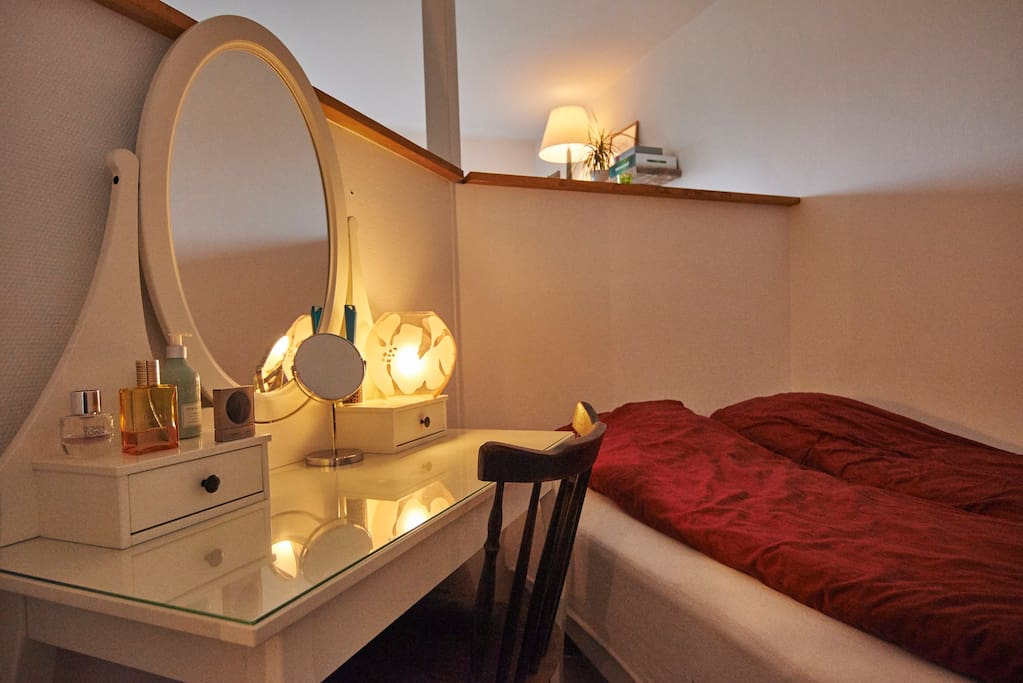 Bedroom area with a vanity table