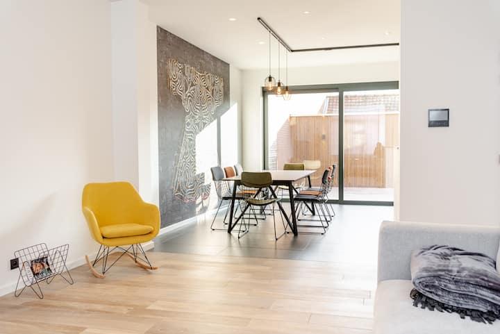 Sfeervol duplex app met privé terras en IR cabine