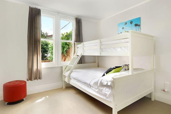 The up bed is 1.0m X 2.0m and the bottom bed is 1.5m X 2.0m;