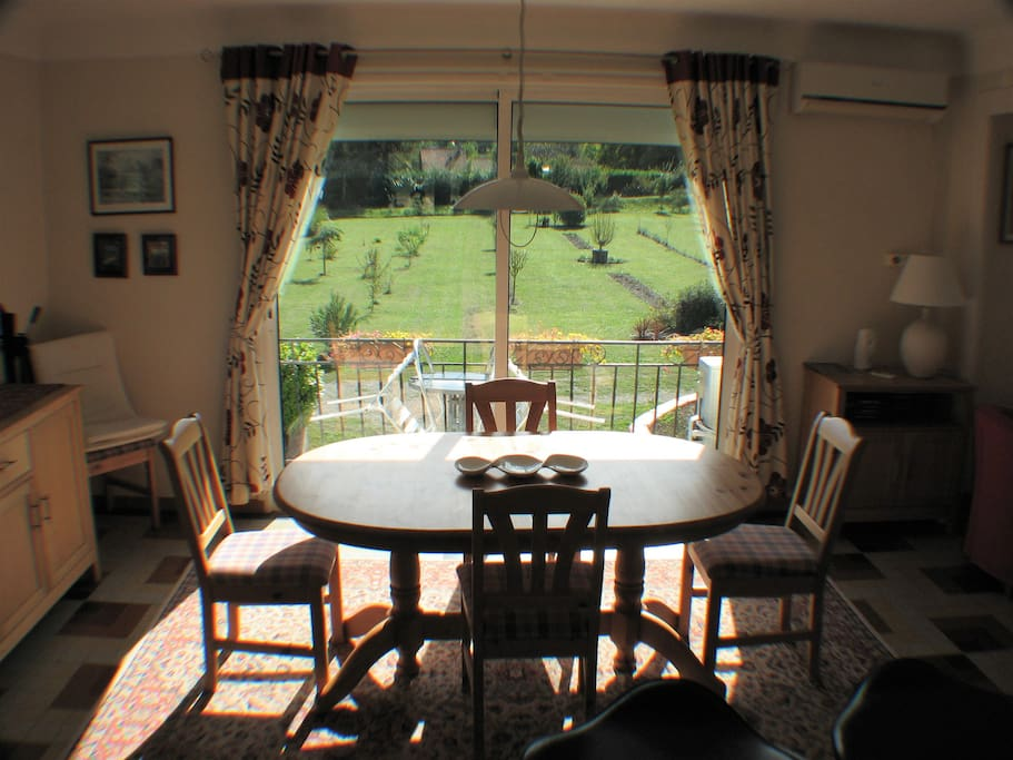 Dining Area - Table extends to seat eight.