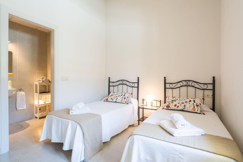 Main bedroom high quality double glaze wooden windows and Mallorquinas facing a gorgeous private inner patio