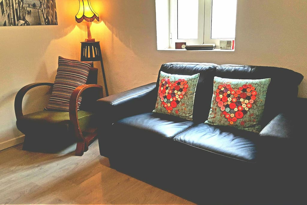 Cosy living room where you can relax after a busy day sightseeing