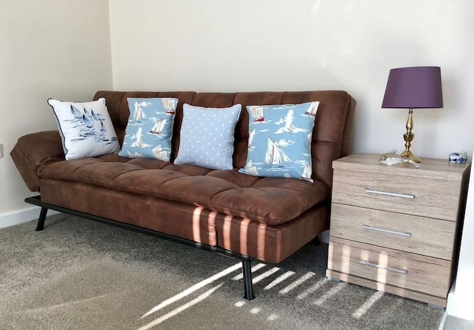 Living room futon sofa/bed, with quick click dropping arms and back; very easy.