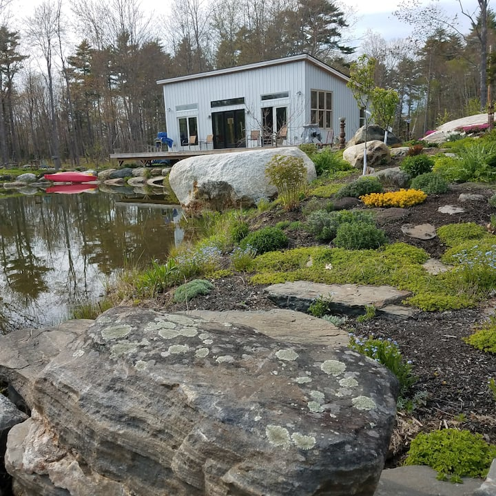 Small, modern house on private pond, with gardens