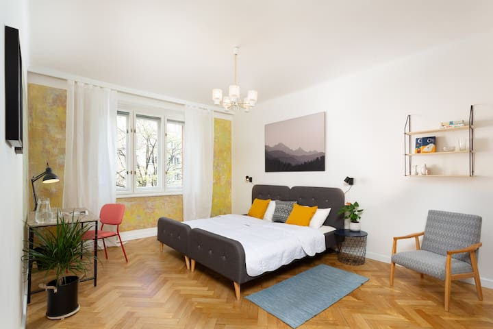 Spacious room in colourful apartment