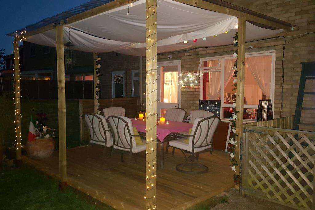 Outside covered pergola decking area. Smoking permitted outside