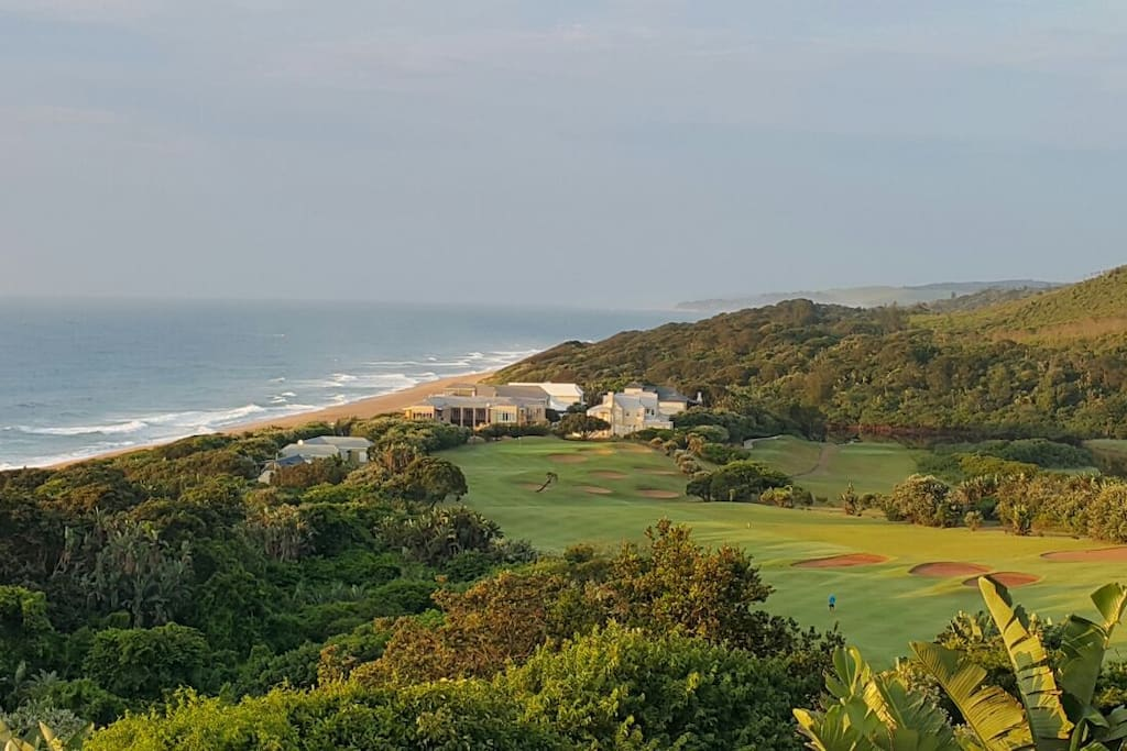 The cottage is one of the buildings at the end of the tee