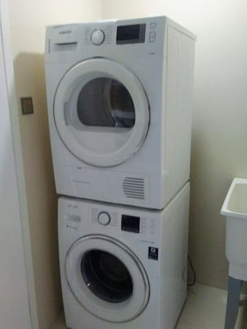 Washer and dryer located with condo unit for easy convenience