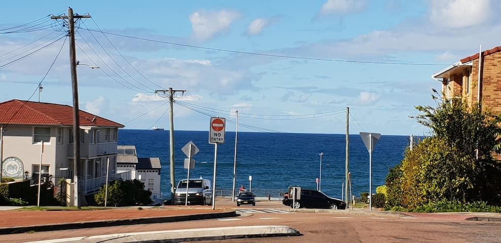 Photo is from the driveway . Surf club is white building on lower left.