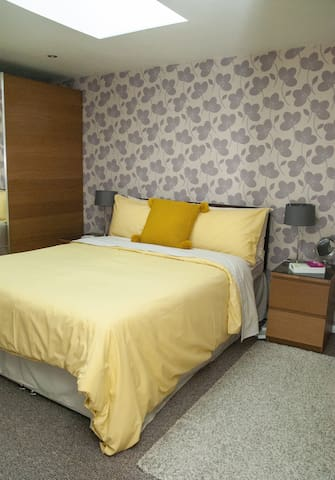 Comfortable double bed with memory foam mattress, velux window with electric blackout blind
