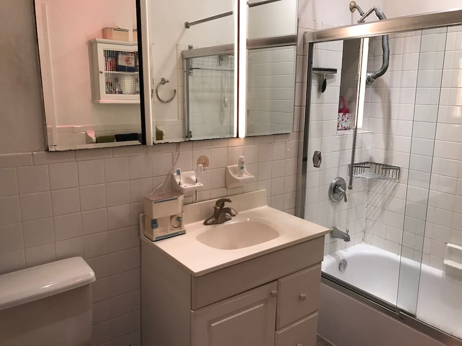 Bathroom a sink, shower toilet