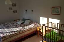 Bedroom, sleeps 2+baby. Floor 1