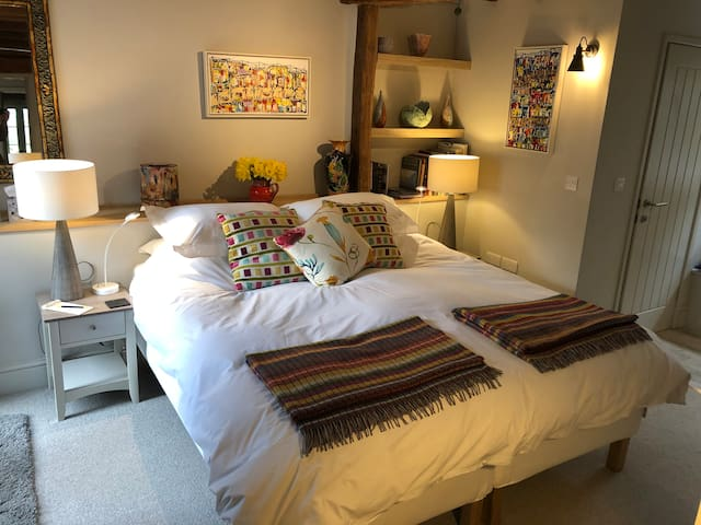 Comfortable King sized Bed with side tables including detail reading lights