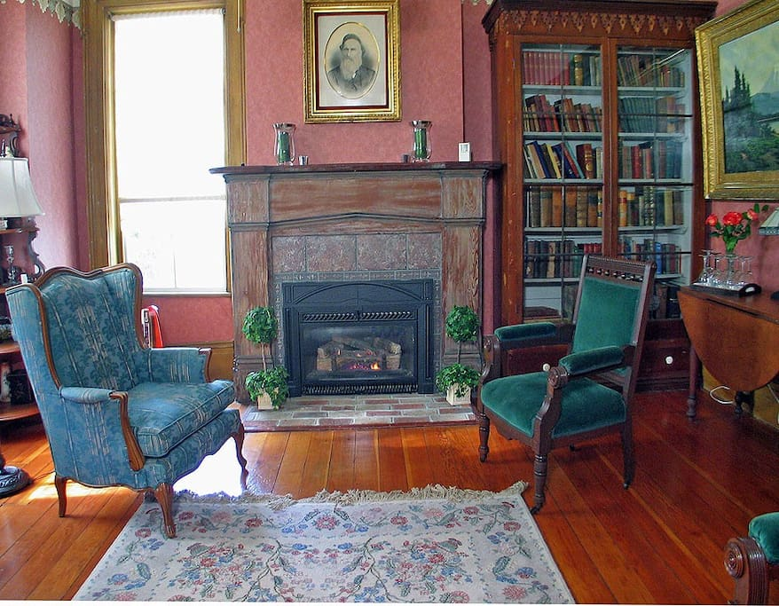 The back parlor with fireplace. Place to chat and visit, read o play board games, even sip a glass of wine!