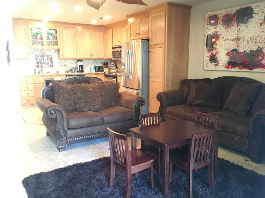 Family Room with a TV, Real Wood Fireplace, Adult table for four and coffee table or kids table option.