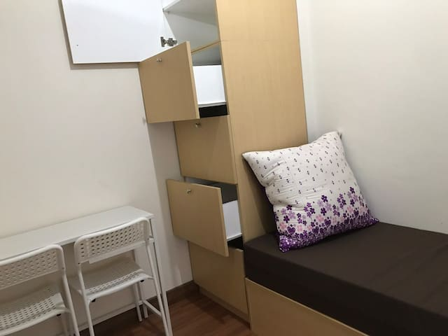 Second bedroom with efficient wall storage and working corner