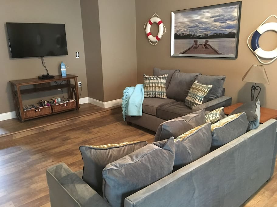 Large first floor family room with flat screen TV and game room