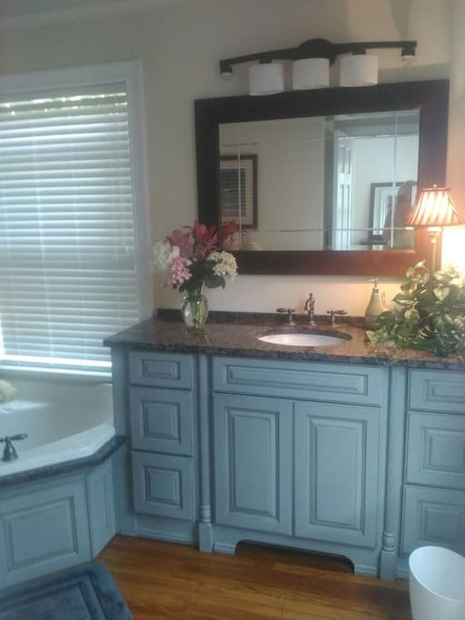 Shared bath includes large double soaking tub with hand held shower