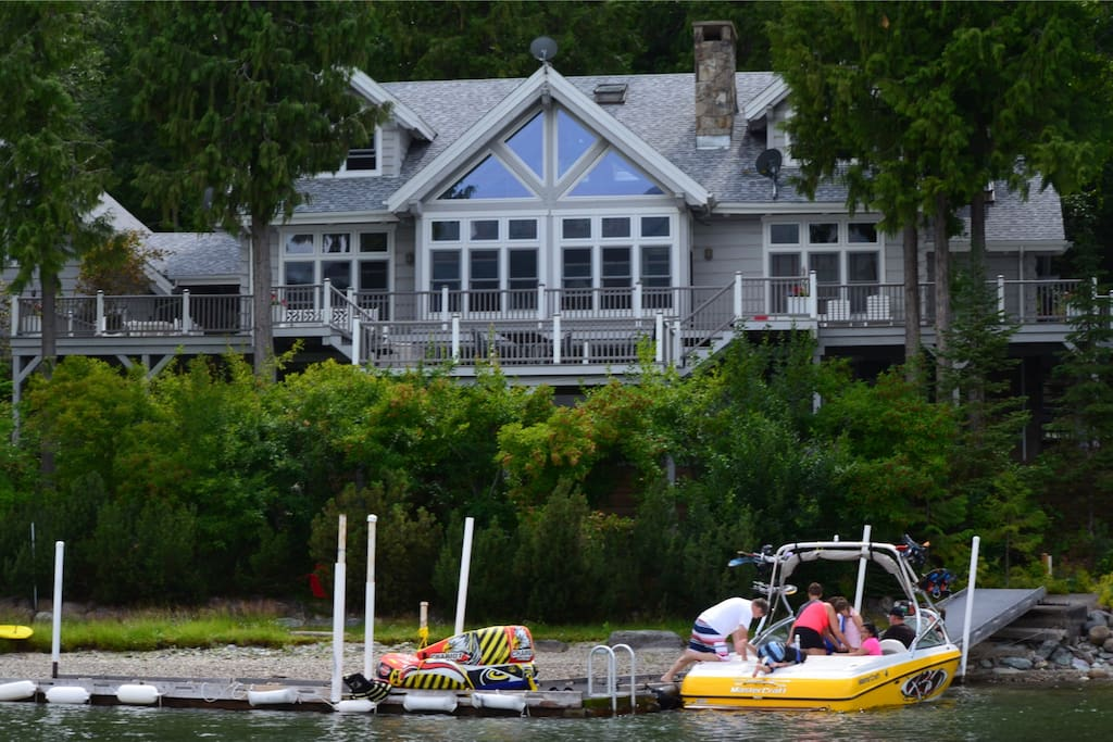 View of Boat Dock with guests ski boat