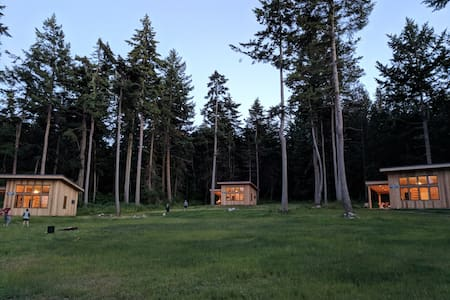 3 cabins on 21 acres with private beach