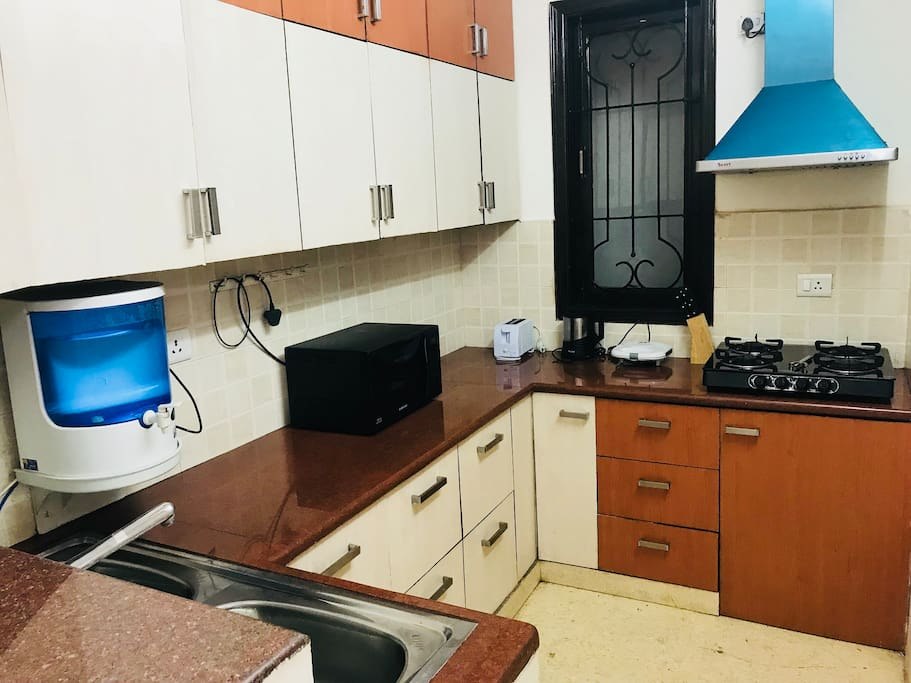 Fully Furnished Modular Kitchen with all necessary amenities like RO water purifier, Microwave, sandwich maker, toaster etc.