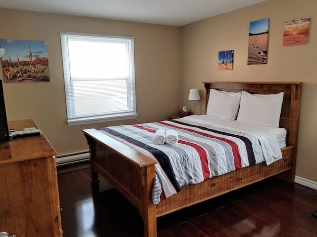 Wind Down on this Comfy Queen Bed near the Falls!