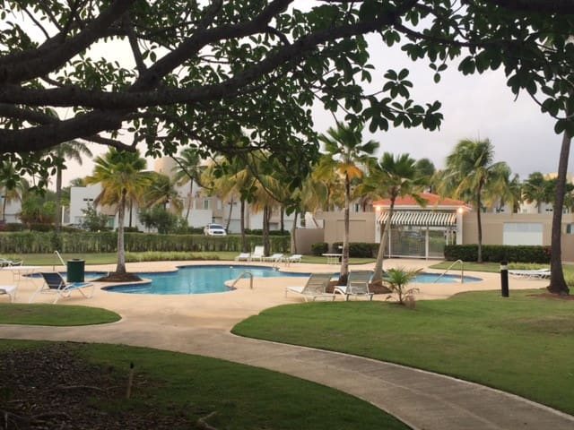 Community Pool Area with Lounges and Gazebo