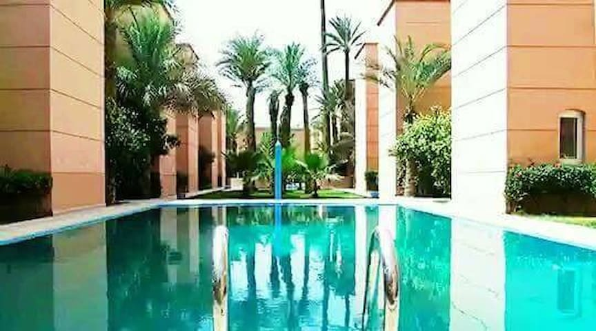 Moroccan riad in a residence with swimming pool