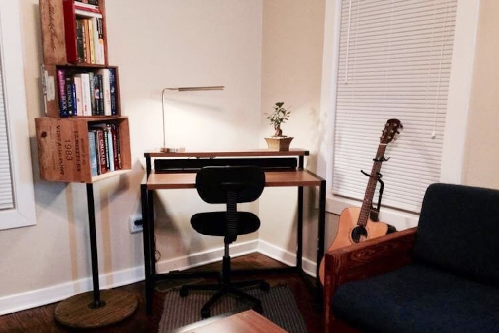 Living room desk, sound bar, guitar