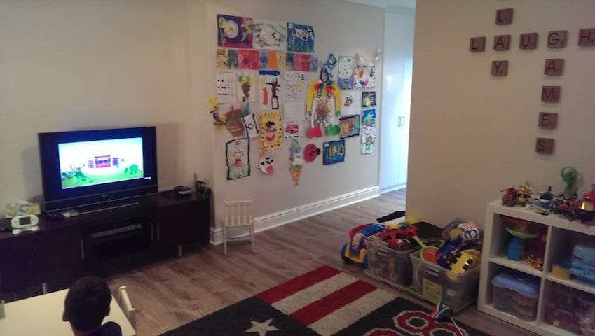 Separate kids playroom with couch
