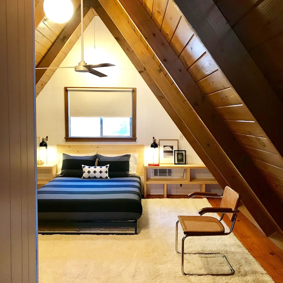 UPSTAIRS BEDROOM with high ceilings and built-in shelving